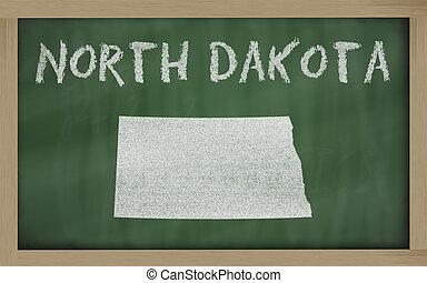 outline map of north dakota on blackboard