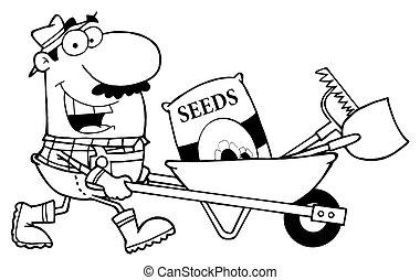 Caucasian Male Landscaper Pushing Seeds, A Rake And Shovel In A Wheelbarrow