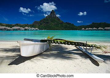 Outrigger canoe against Bora Bora - Beautiful shot of a...