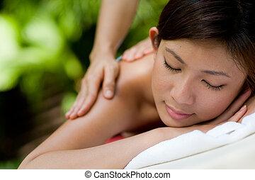 Outside Massage - A young woman enjoying a massage outside