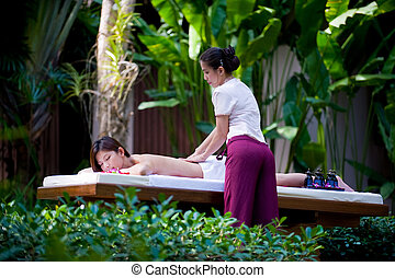 Outside Massage - A young woman having massage outside in ...