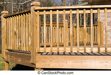 Close-up of the outside angles of a wooden deck. Useful to homebuilders and landscape planners.