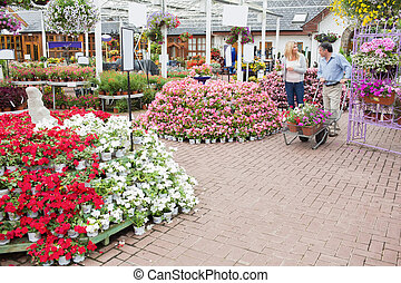 Outside of garden center with many types of plants and flowers