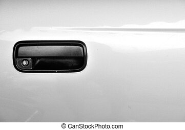 Outside Old model of black car door handle, right side.