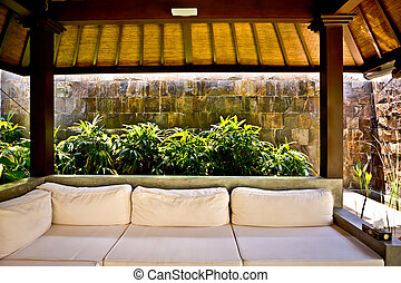 Outside patio area with a sofa and traditional room