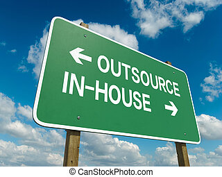 outsource inhouse - A road sign with outsource inhouse words...