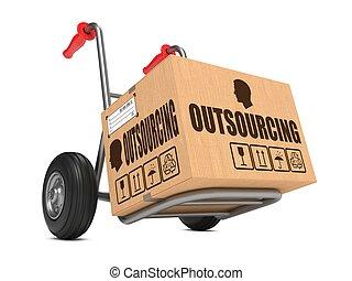 outsourcing, -, caja de cartón, en, mano, truck.