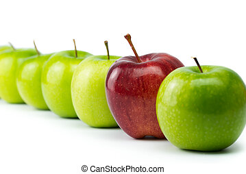 Outstanding - Red apple standing out in a row of green...