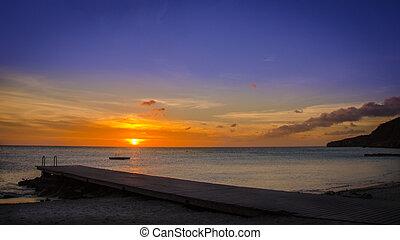 Outstanding sunset at the Porto Mari white sandy Beach