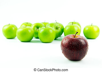 Outstanding talent concept - Red apple standing out among...