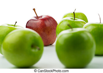 Outstanding talent - Red apple standing out among green...
