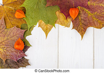 Outumnal background, texture, frame with leaves on wooden