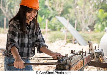 ouvrier bâtiment, site, construction, femelle asiatique