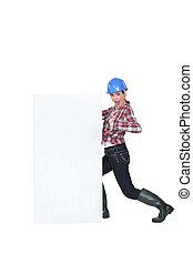 ouvrier construction, femme, billboard.