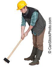 ouvrier construction, sledgehammer.