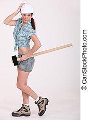 ouvrier construction, tenue, femme, sledgehammer.