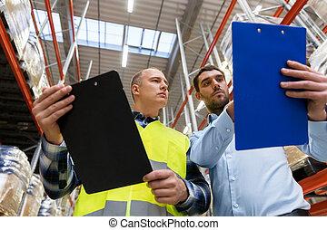 ouvrier, et, homme affaires, à, presse-papiers, à, entrepôt