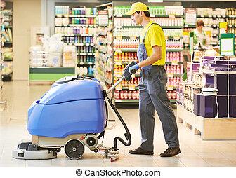 ouvrier, nettoyage, magasin, plancher, à, machine
