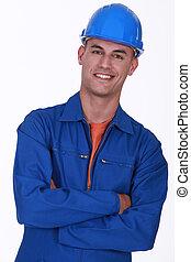 ouvrier, sourire, construction, bras pliés