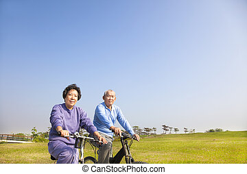 ouwetjes, biking, paar, park, aziaat