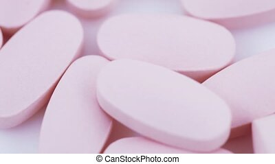Oval pink tablets on plate