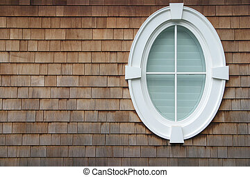 Oval Window - An oval window on the side of a house with ...