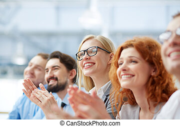 Ovations - Photo of happy business people applauding at...