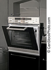 Oven - Big silver electric oven in the black kitchen