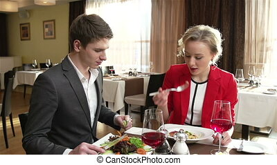 Over A Lunch - Elegant couple having a talk over a lunch at...