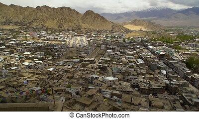 Medium high-angle still shot of overcrowded traditional slum buildings of Leh, Ladakh