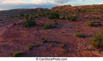 Over Dirt Road Utah Landscape at Sunset Aerial