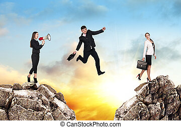 Over gap - Image of young businessman jumping over gap at...