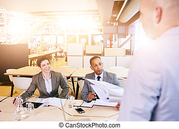 Over the shoulder of professional businessman conducting a presentation