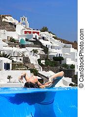 woman enjoying the view of Santorini
