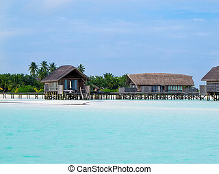 Over water bungalows at maldives - Beautiful beach with...