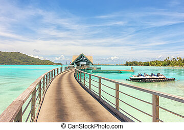Over water bungalows into amazing green lagoon at Bora Bora island