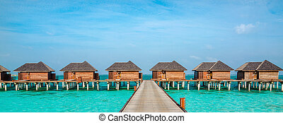 Over water bungalows on a tropical island, Maldives