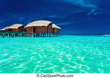 Over water bungalows with steps into lagoon