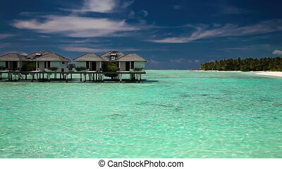 over water villas on island - View of the over water villas...