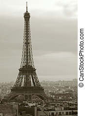 Sepia image of the Eiffel Tower on a gloomy day in Paris.