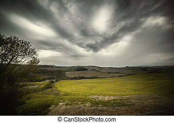 Overcast sky over a field in Tuscany