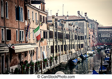 Overcast sky over a small canal in Venice