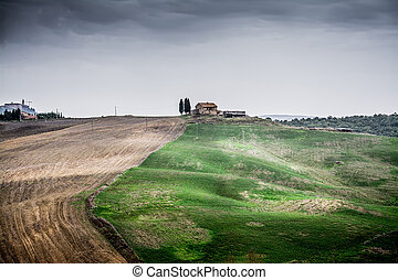 Overcast sky over a small hill in Tuscany