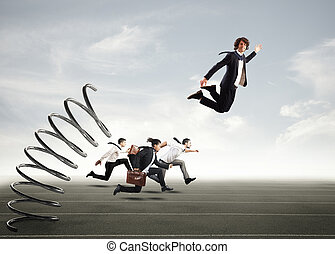 Overcome and achieve success - Businessman jumping on a ...
