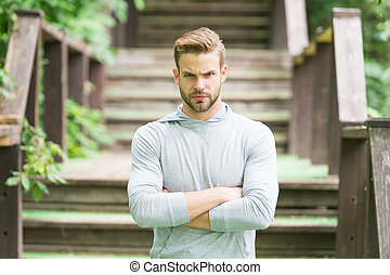 Overcome any obstacles. Sportsman lifestyle. Handsome athlete stairs background. Male beauty. Sport wellbeing and self care. Handsome man sporty outfit look confident. Guy handsome bearded face