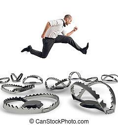Overcome traps - Man runs quickly to overcome the traps