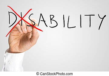 Overcoming a disability concept with a man writing the word Disability on a virtual interface and then crossing through the - Dis - with a red marker pen as a motivational call to overcome adversity.