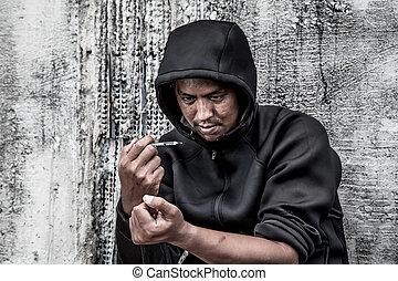 overdose asian male drug addict hand, drugs narcotic syringe in action