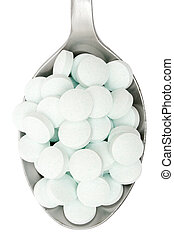 Overdose - Silver spoon full of tablets. Isolated on a white...