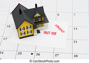 Overdue Mortgage - An overdue bill beside a house on...